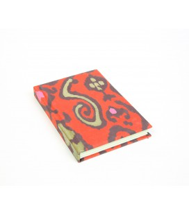 Small hard cover red and gold notebook