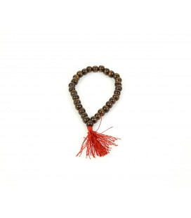 Red pompon brown wood mala bracelet